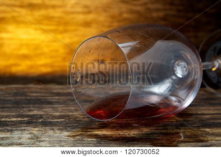 Overturned glass of wine on floor