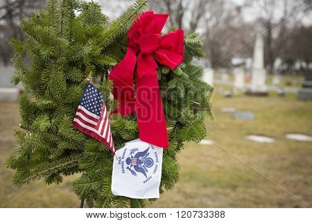 SUCCASUNNA, NJ-DEC 12, 2015: The U.S. Coast Guard ceremonial wreath stands between the First Presbyterian and the United Methodist Church combined cemeteries for the 2015 Wreaths Across America event.