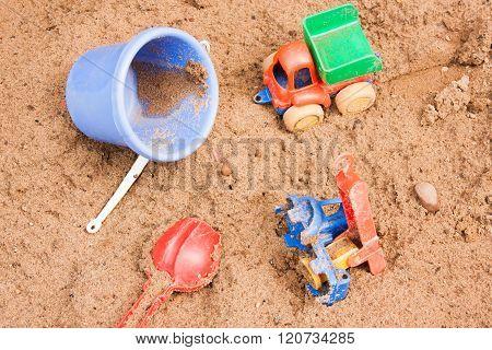 Child's Toys Lie On Sand
