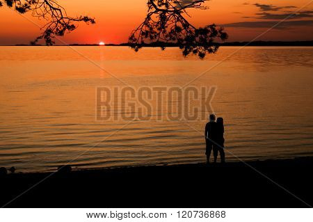 Young lovers in sunset