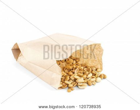 Processed peanuts in paper bag over white background with copy-space shallow focus