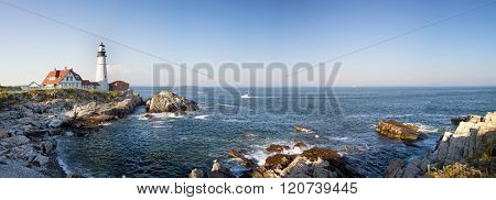 A panorama of the Portland Head lighthouse and rugged coastline, Maine, USA
