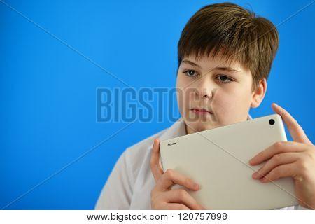 Portrait of teenage boy with tablet computer in hands