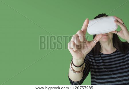 A Woman Touching Something During 3D Experience With A Vr Headset
