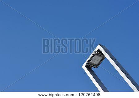 Modern Street Lamp Against Blue Sky