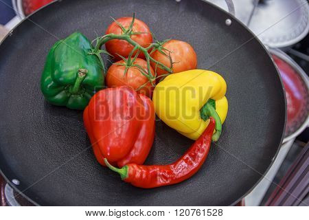 Colorful Peppers And Tomatoes In A Pan. Food