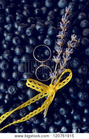 wedding rings in berries