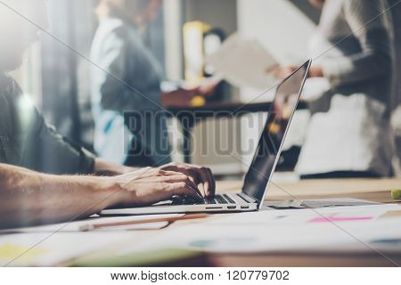 Bearded businessman working with team new project. Generic design notebook on wood table.  Analyze p