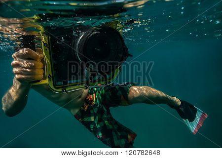 Diver taking underwater photo.
