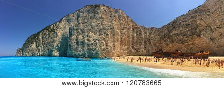 NAVAGGIO BAY/ZAKINTHOS ISLAND, GREECE - CIRCA JUNE 2015: Tourists flocking in famous Wreckship Pirate's Bay