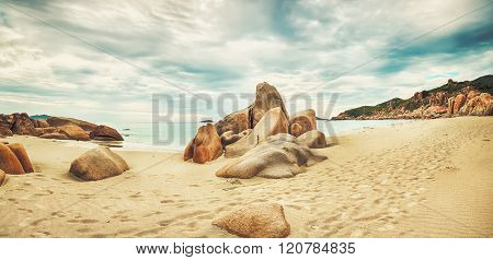 Beautiful beach panorama. Stones on the foreground