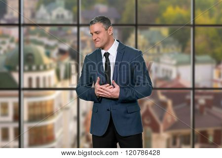 Angry businessman on urban background.