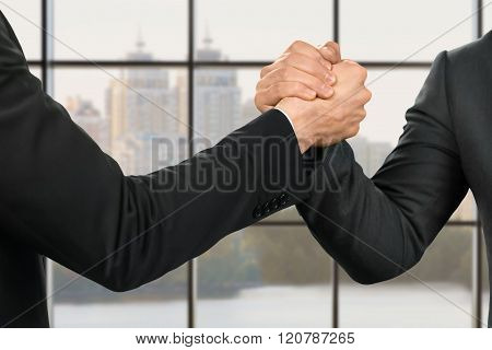 Businessmen's strong and friendly handshake.