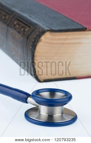 book and stethoscope,