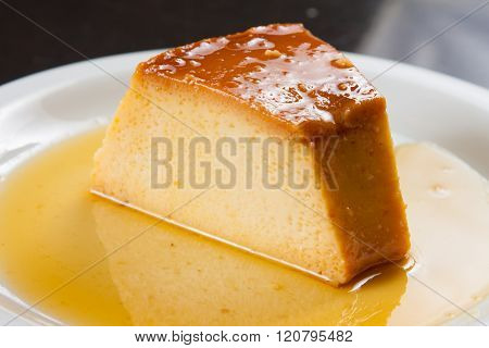 Traditional Brazilian Milk Pudding Dessert with sugar sauce poster