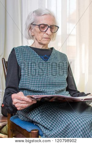 Ninety Years Old Lady Reading Newspapers