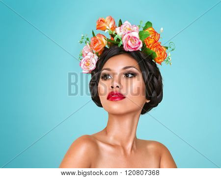Beautiful young asian woman with wreath on head isolated over green background