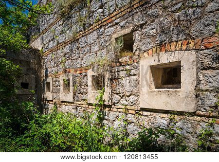 Ancient fortification wall with windows
