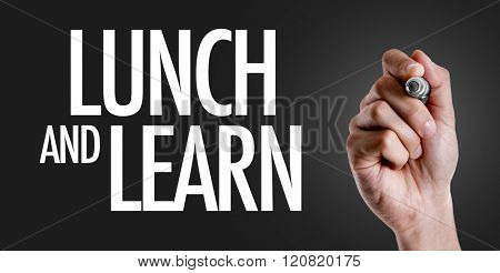 Hand writing the text: Lunch and Learn