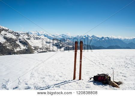 Ski Tour Equipment On The Summit, Majestic Mountain Range