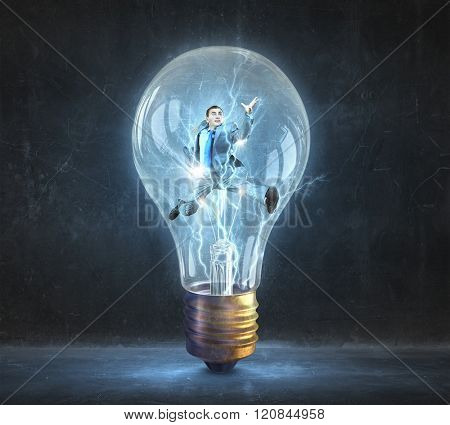 Man inside of electric bulb