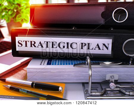 Strategic Plan on Black Ring Binder. Blurred, Toned Image.