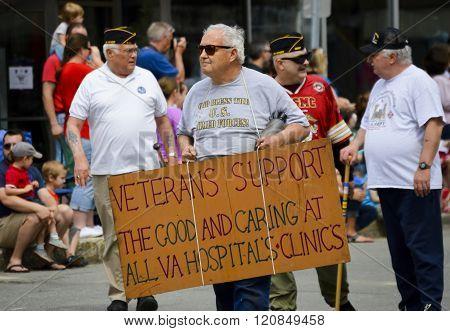 Bangor, Maine/USA-May 25: Veteran carrying a cardboard sign stating