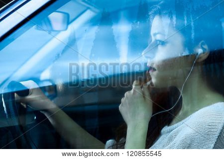 Woman Speaking while Driving