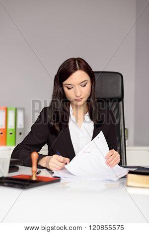 Brunette Woman Notary Public Reading Testament.
