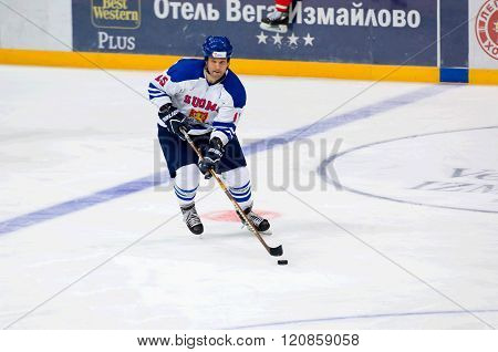 MOSCOW - JANUARY 29 2016: Liro Jarvi (15) dribble on hockey game Finland vs Russia on League of World legends of Ice hockey championship in VTB ice arena Russia. Russia won 6:2