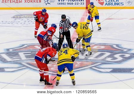 C. Berglund (22) And M. Hostak (20) On Face-off