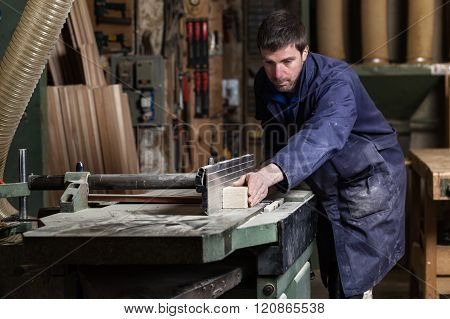 Carpenter Man Cutting Wood With Tablesaw