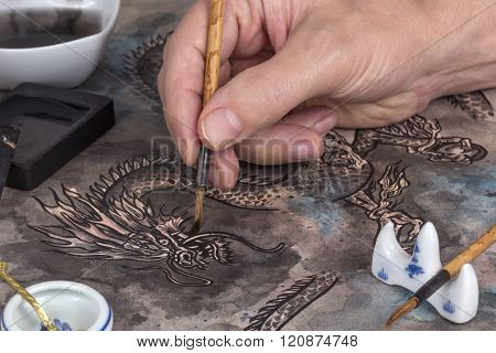 Artist Painting A Chinese Dragon