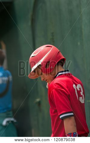 Baseball boy getting ready to bat.