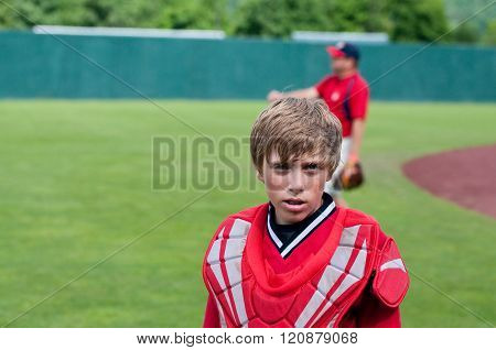 Little league baseball catcher looking at camera.