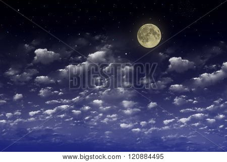 Beautiful blue night sky with clouds and fullmoon and stars