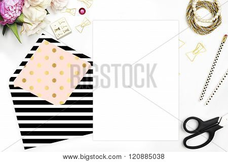 Feminine scene. Glamour style. Gold and stationery items on white table. View up. Flat lay. Wedding template invitation. Place your text or your artworks. bouquet of flowers, peonies with the tulips. poster