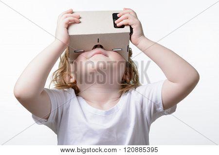 Child Playing A Virtual Reality Glasses