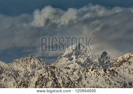 Snow covered mountain top. Winter season in the itlian alps