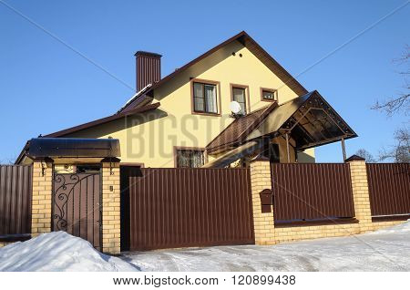 Yellow Cottage In Winter
