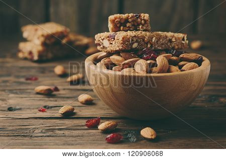 Cereal Bar With Almond And Berry On Thw Wooden Table