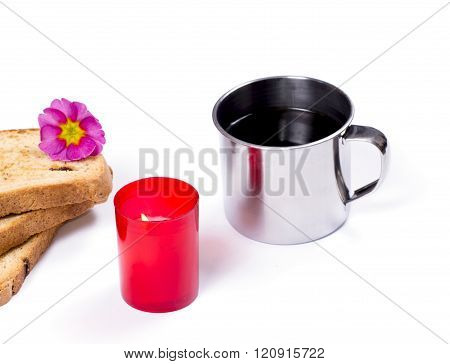 Steel Mug, The Red Burning Candle And Three Slices Of Bread