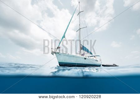 Split shot of the sail boat in the tropical sea