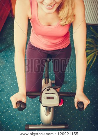 Human Working Out On Exercise Bike. Fitness.