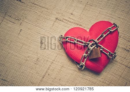 A chained red heart with keys - Closed love concept