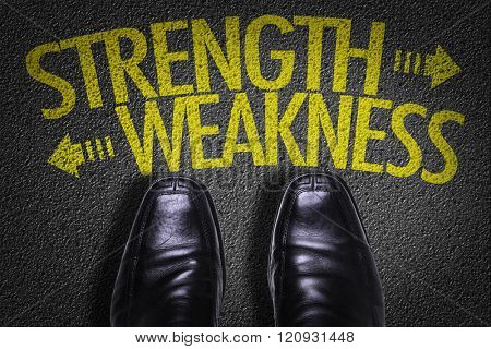 Top View of Business Shoes on the floor with the text: Strength - Weakness poster