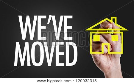 Hand writing the text: We've Moved