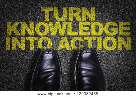 Top View of Business Shoes on the floor with the text: Turn Knowledge Into Action