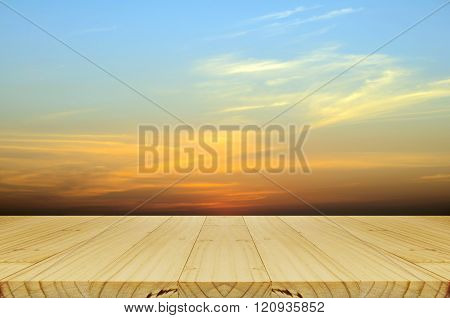 Picnic Wood Table And Blurred Sunrise Background.