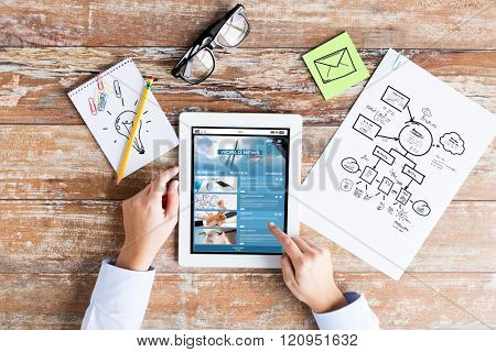 business, people and technology concept - close up of female hands pointing finger to tablet pc computer screen with news web page, scheme and eyeglasses